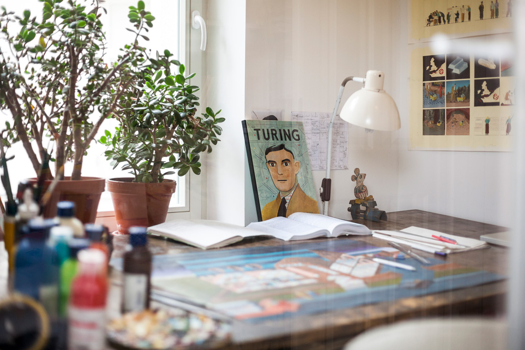 desk of the painter with the book Turing
